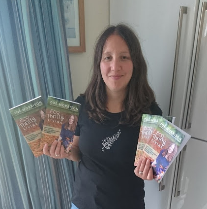 Zoe holding Eco Thrifty Living Books, Eco Thrifty Living book in print